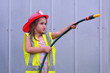 Child girl in fireman costume - 79260859
