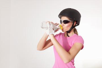 Biker woman drinking water