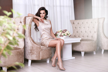 Beautiful sexy woman luxary dress jewelry make-up interior