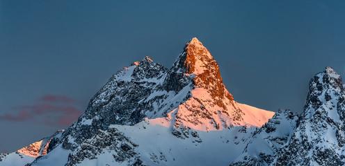 Snowy mountains with last sun summit