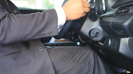 business man drive the car and stop the engine, safely