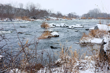 Winter landscape of trees and river with snow