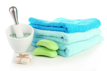 Towels with soap and sea salt isolated on white