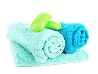 Towels with soap isolated on white