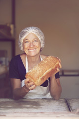 Mature woman with bread