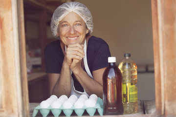 Mature woman selling eggs