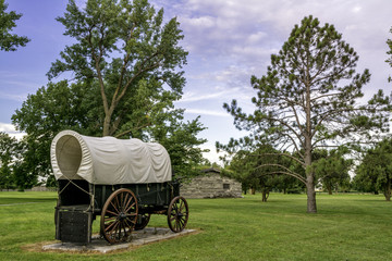 Historic scene with covered wagon and bunk house