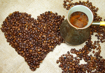 cezve and heart-shaped pattern of the coffee beans