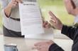 Female hands holding divorce paper