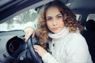 blonde behind the wheel of a portrait