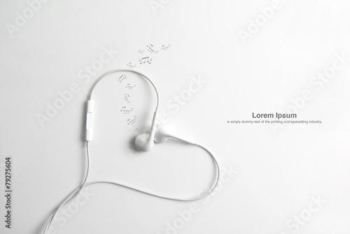 Earphone in shape of heart. on white background. - 79275604
