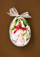 Painted Easter egg with red flower