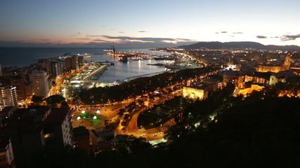Malaga and Mediterranean port in  evening