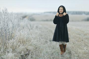 girl in a mink coat winter snow