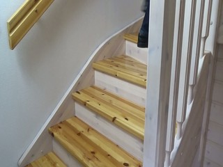 Man stepping up and down in wooden stairs