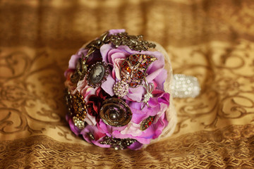 Purple wedding bouquet covered with crystals