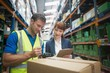 Worker and manager scanning package in warehouse - 79280410
