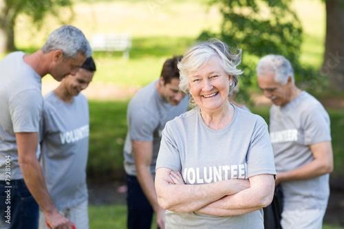 Leinwandbild Motiv Happy volunteer grandmother smiling at camera