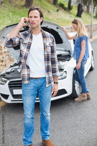 Couple after a car breakdown - 79282467