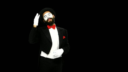 Man mime watches something and uses binocular, alpha channel