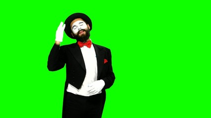Man mime watches something and uses binocular on green screen