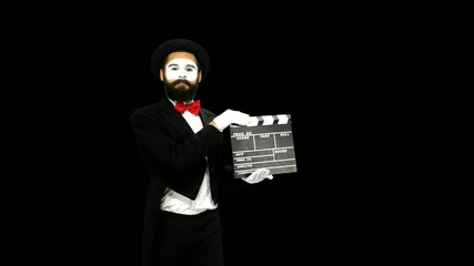 Man mime sneezes using the movie clapper, alpha channel