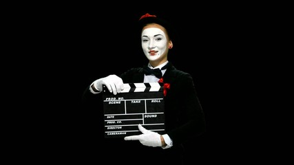 Woman mime uses the movie clapper, alpha channel