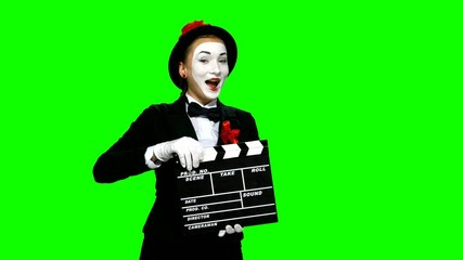 Woman mime uses the movie clapper on green screen