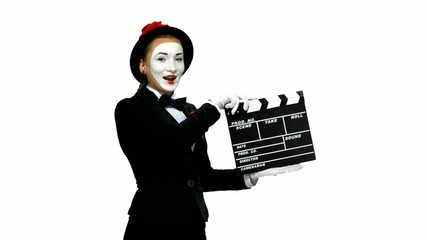 Woman mime uses the movie clapper on white background