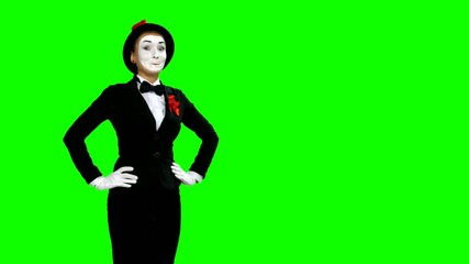 Funny woman mime shows and speaks about something on green