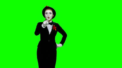 Woman mime writes something in air on green screen