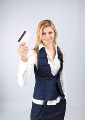 Business woman holding a credit card