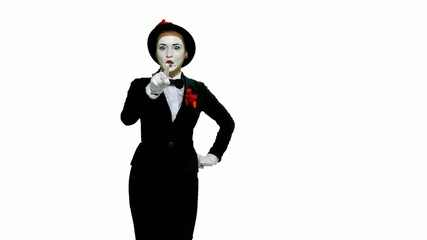 Woman mime writes something in air on white background