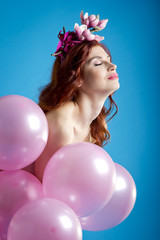 Red-haired girl with balloons