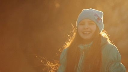 child laughing in sunset light