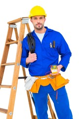 Electrician holding cables and multimeter