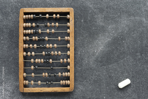 vintage abacus with chalk - 79286464