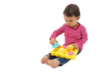 little girl learning shapes, early education concept