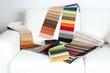 Scraps of colored tissue on sofa close up - 79287633