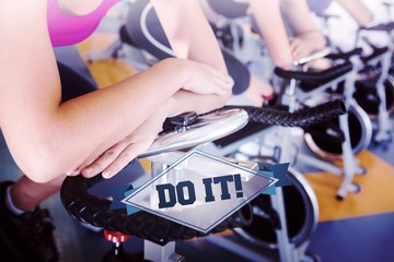 The word do it! and spin class working out in a row