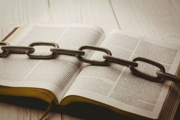 Open bible and heavy chain
