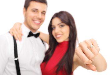 Woman posing with her fiancée and showing a ring