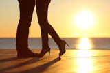 Couple legs falling in love hugging at sunset - Fine Art prints