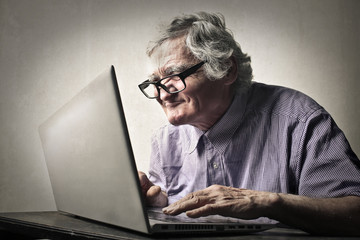 Elderly man using technology