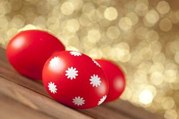 Red Easter eggs on gold background