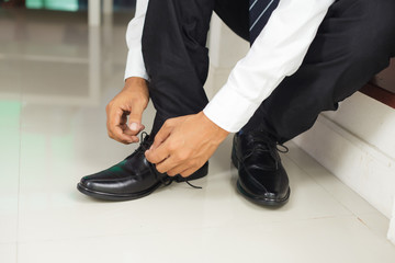 Man tying shoes