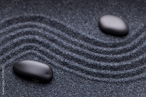 Poster Stenen in het Zand Zen garden with a wave lines in the sand with irregular black st