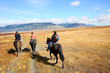 People riding horses in Patagonian steppe - 79293272