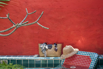 Holiday at the pool side with red concept