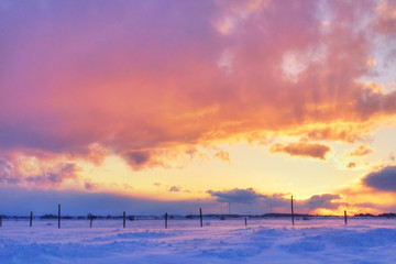 Colorful sunset over snow
